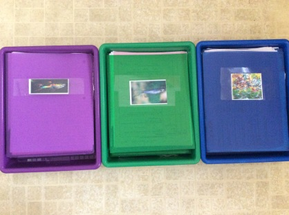 Bins with the table folders for each class period in them.